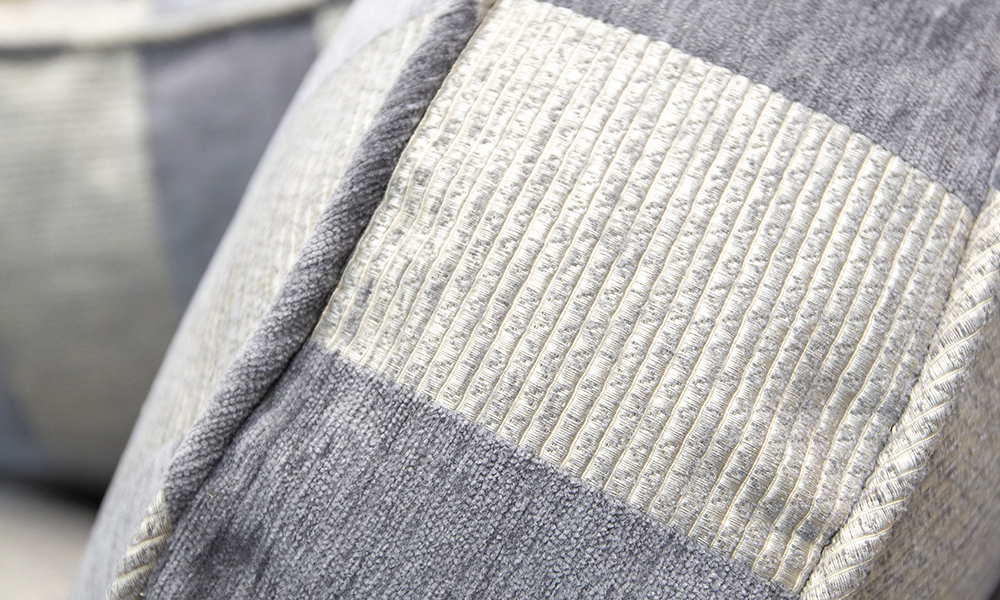 Back cushion detail in Lyra Stripe Charcoal, Gold Collection Fabric