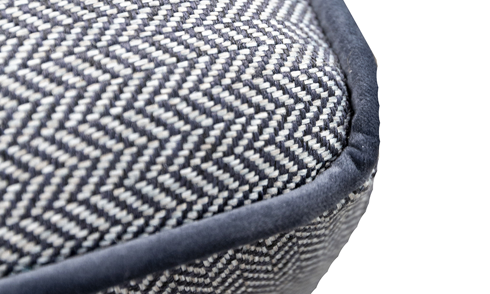 Atlas Footstool Detail in Porto Charcoal, Contrast Piped in Luxor Tempest, Silver Collection Fabric