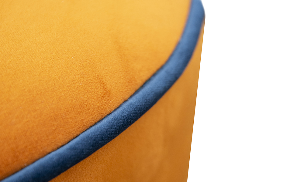 Pluto Footstool Close Up in Luxor Marigold, Contrast Piping Luxor Pacific, Silver Collection of Fabrics