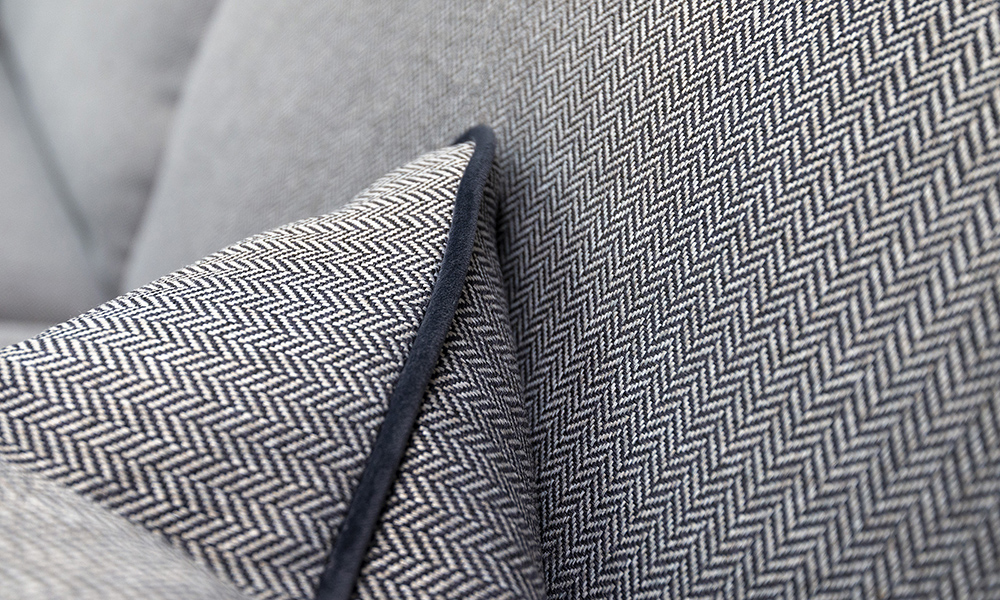 Cushion Detail in Porto Charcoal and Contrast Piped in Luxor Tempest, Silver Collection Fabric