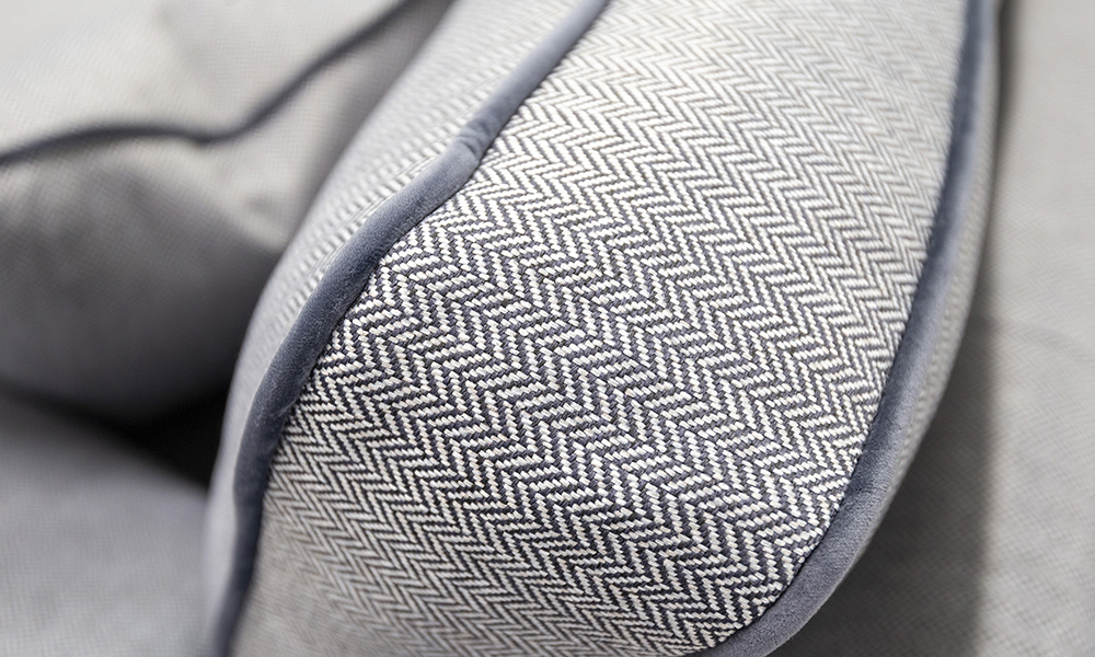 Atlas Corner Back Cushion Detail in Porto Charcoal and Contrast Piped in Luxor Tempest, Silver Collection Fabric